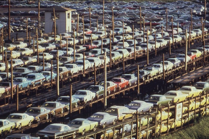 New cars loaded onto railroad cars at Lasher and I-75 in Detroit, in 1973. Photo by Joe Clark. Source: Wikipedia